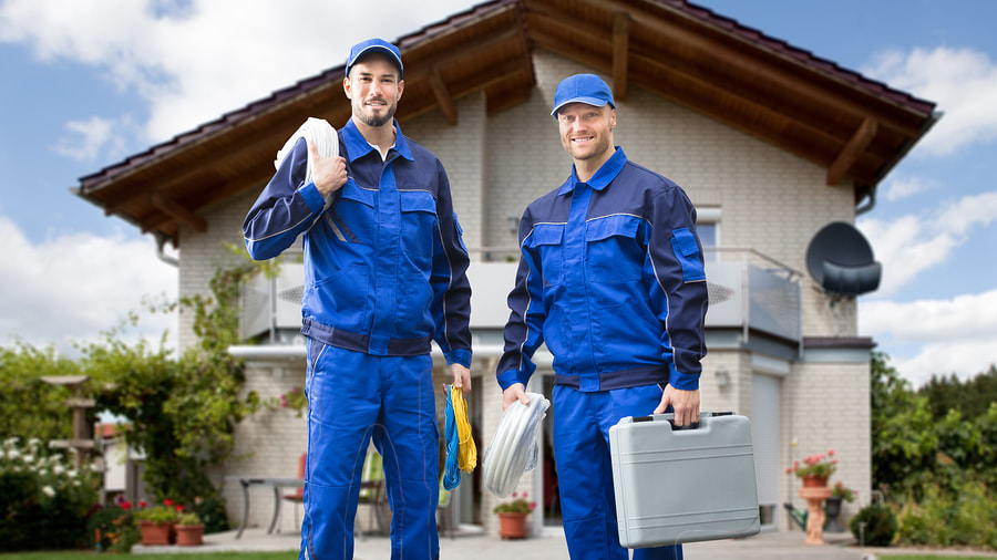 men holding electrical tools