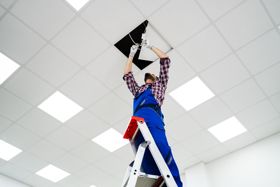 man fixing a ceiling